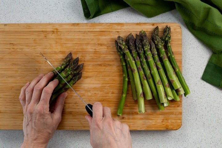 Asparagus tips are in the process of being cut.