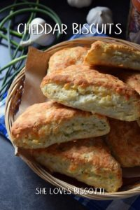 A few cheddar cheese biscuits in a wicker basket.