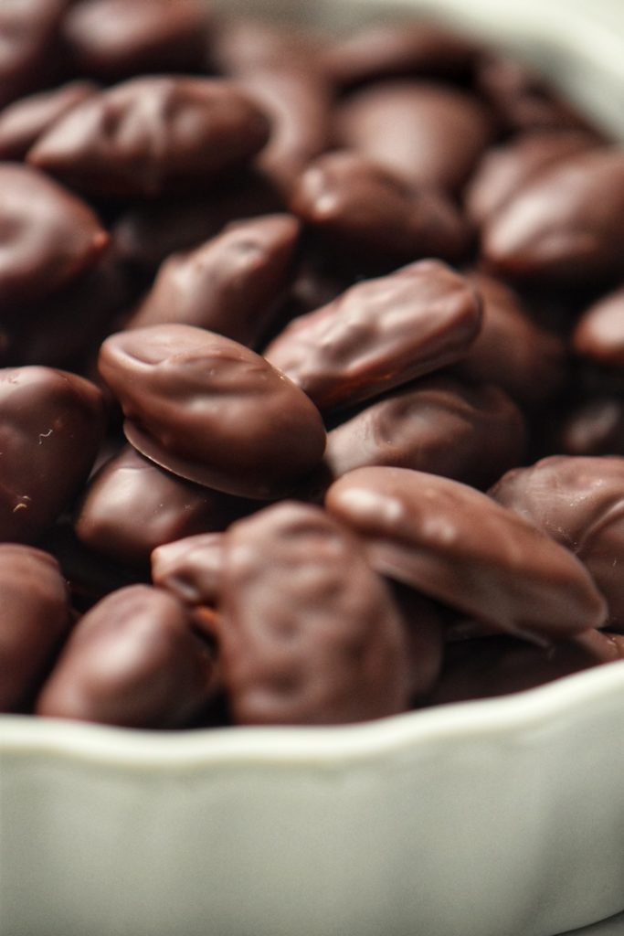 A close up shot of the chocolate covered almonds.