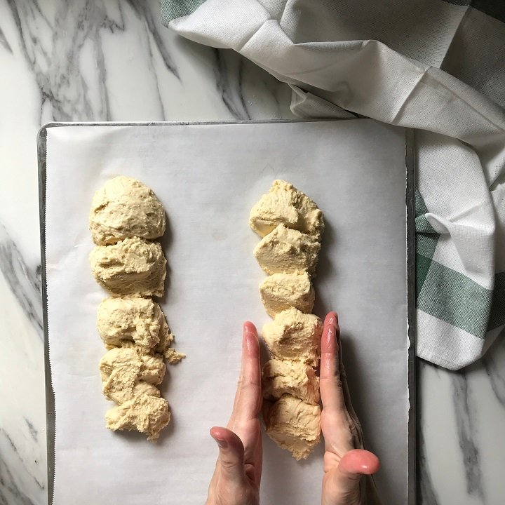The biscotti dough is being shaped into logs.