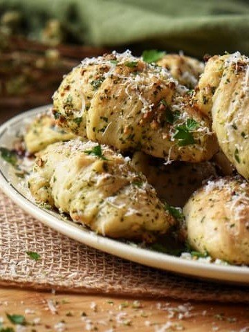Garlic knots garnished with grated cheese ready to be served.