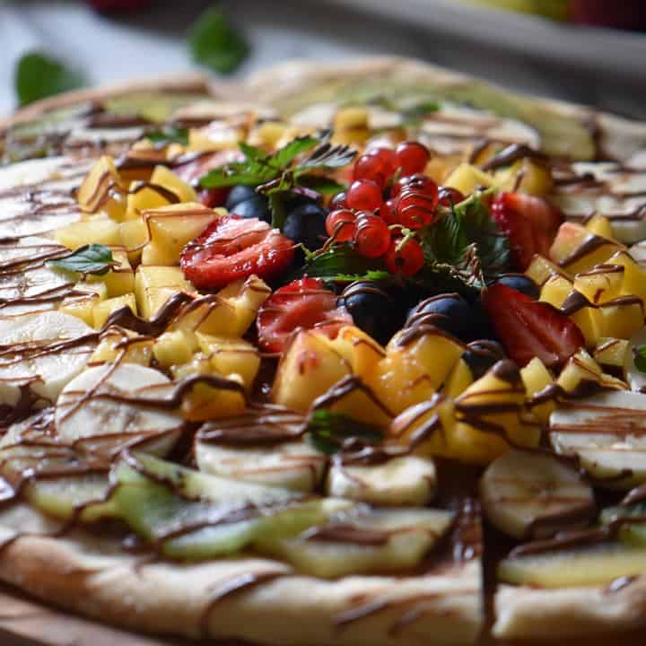 Peaches, strawberries, bananas and kiwis are just some of the fruits used for this chocolate fruit pizza