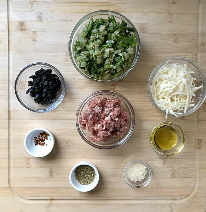 Some of the ingredients required to make this pizza rolls recipe include sauteed broccoli rabe, loose Italian sausage and mozzarella.