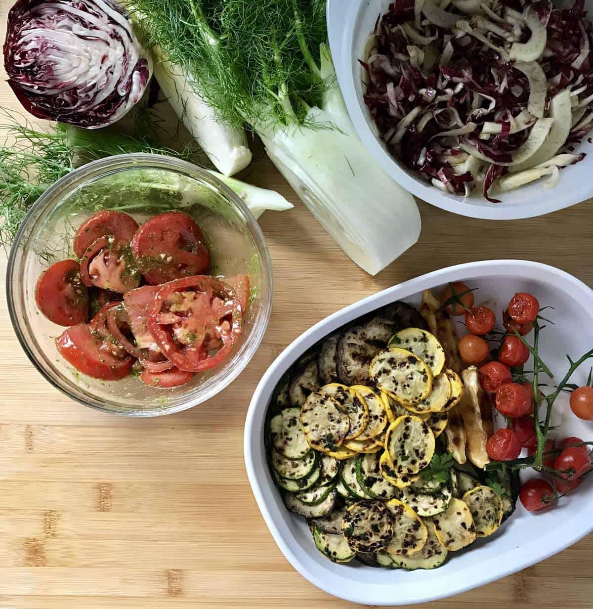 Grilled vegetables in bowls.