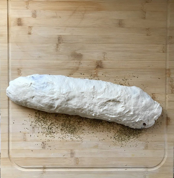 The sausage bread is rolled in dried oregano.