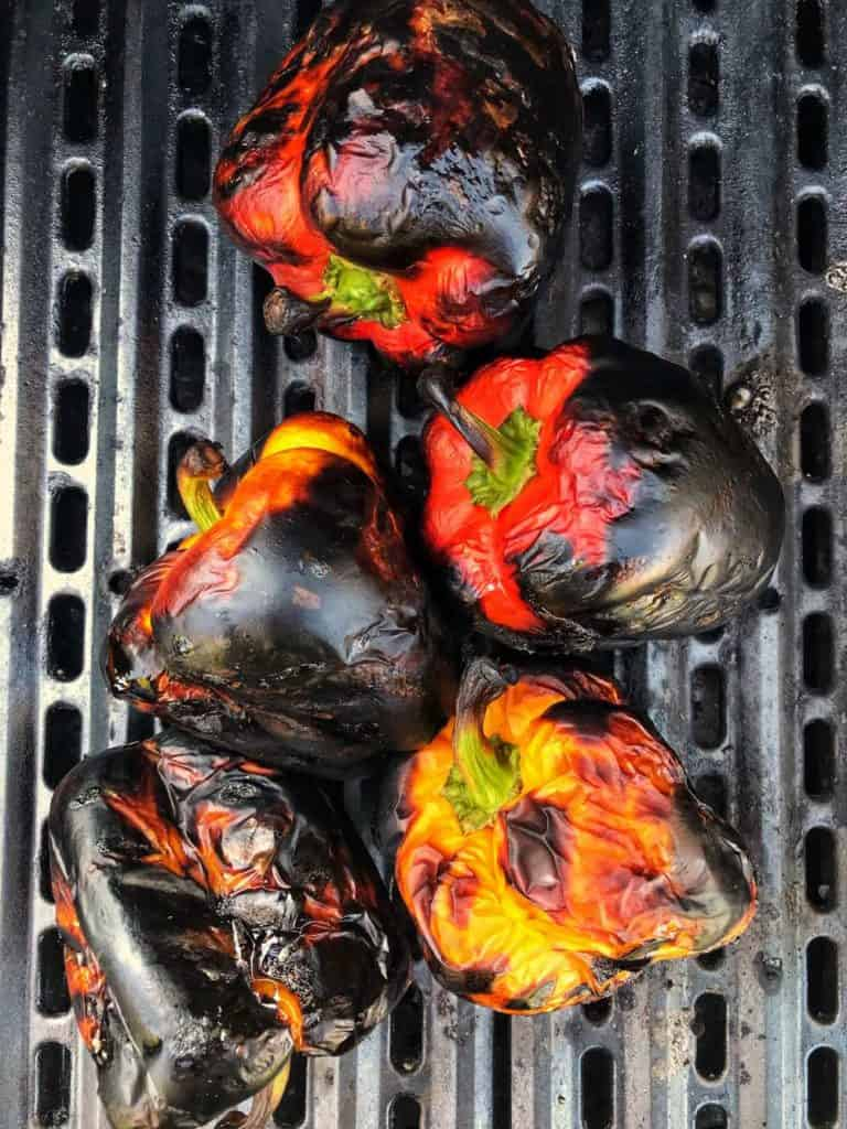 Roasted bell peppers on a grill.