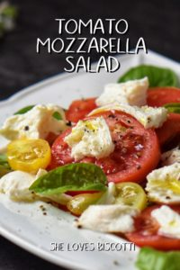 Sliced tomatoes, mozzarella cheese and basil leaves create the perfect caprese salad.