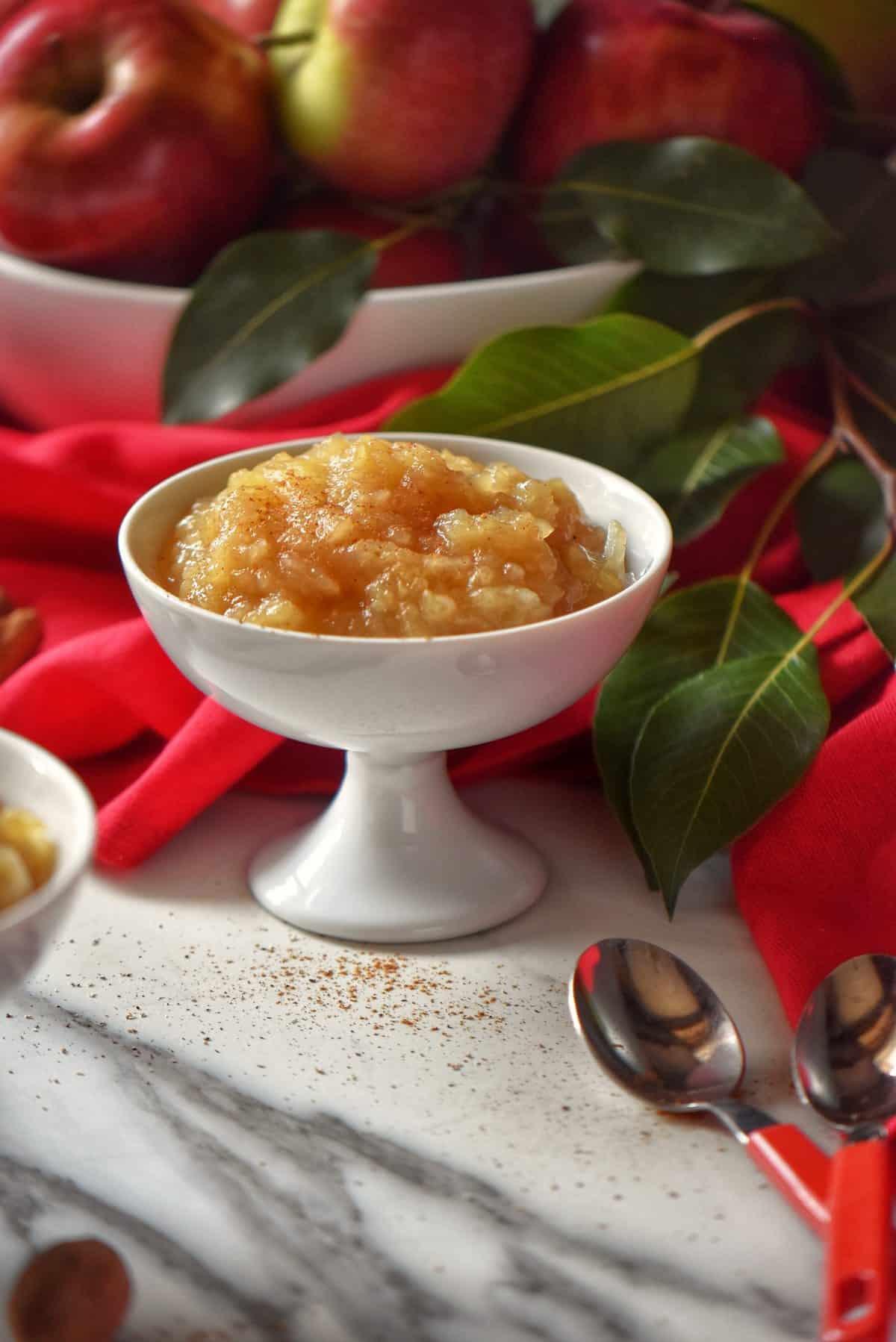A generous bowl of sugar free applesauce in a white ceramic dish.