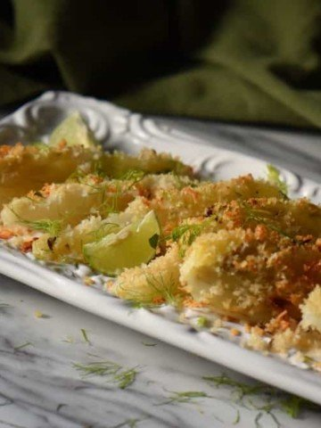 A white ceramic dish with panko encrusted roasted fennel.