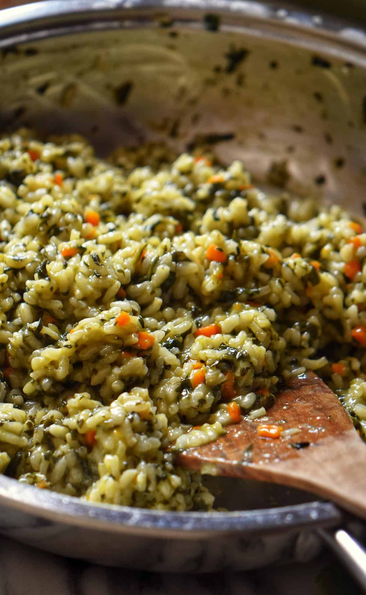 A large saucepan of spinach risotto.