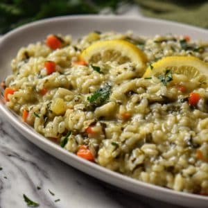 Spinach risotto in a white serving dish.