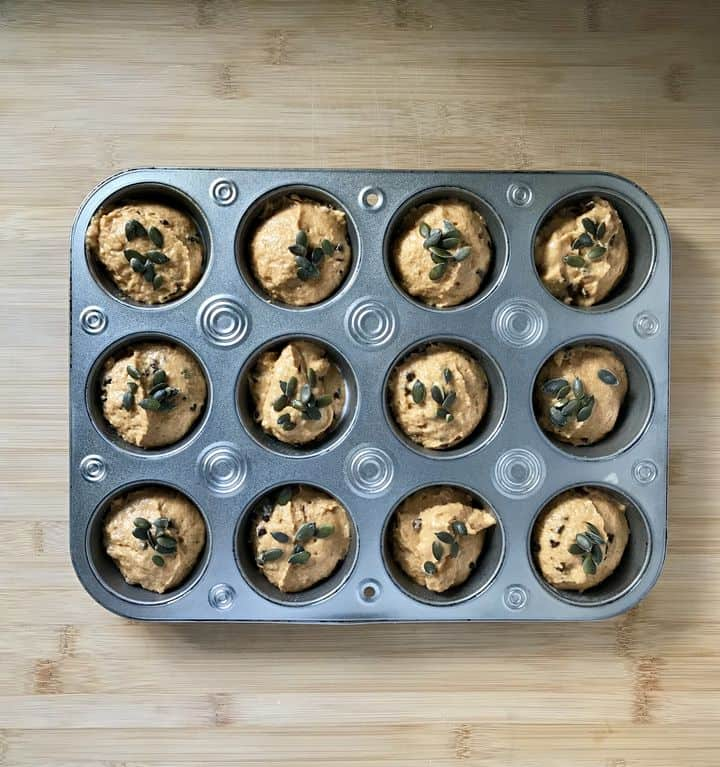 A tray of portioned muffins ready to be baked.