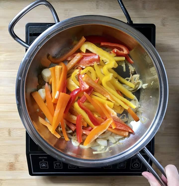 An assortment of bell peppers added to the frying pan to make the peperonata recipe.