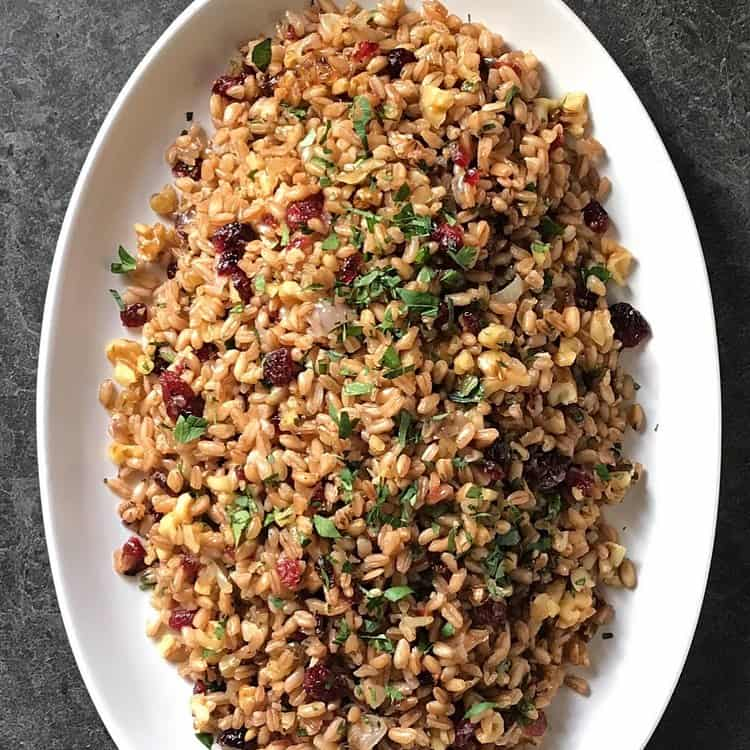 A colorful warm farro salad in a