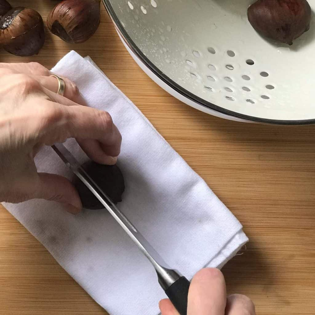A chestnut in the process of being scored.