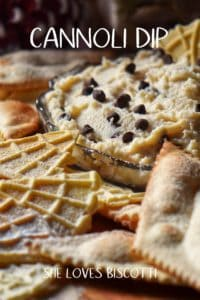 A cannoli dip with chocolate chips surrounded by pizzelle.