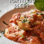 Italian tortellini in a white pasta dish.