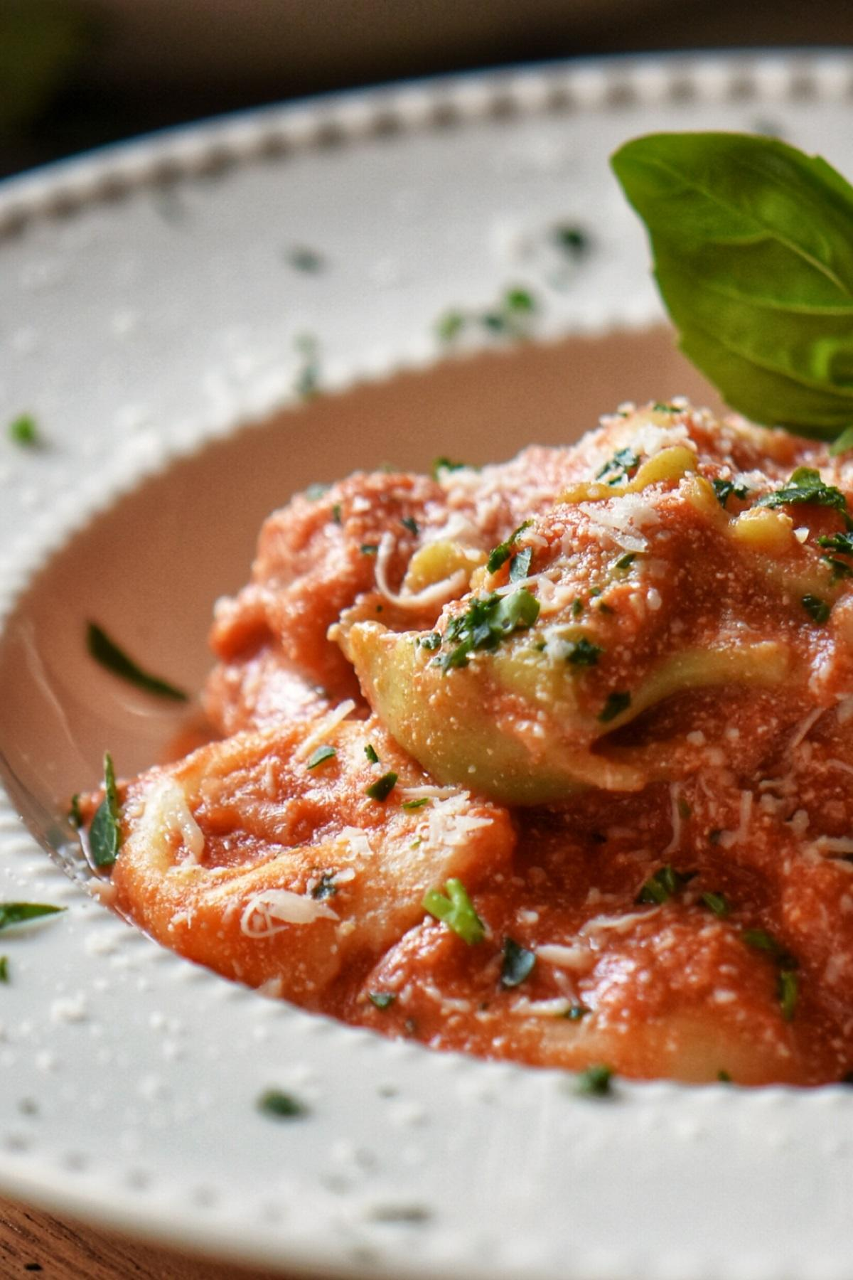 Tortellini with Creamy Tomato Sauce in a white dish.