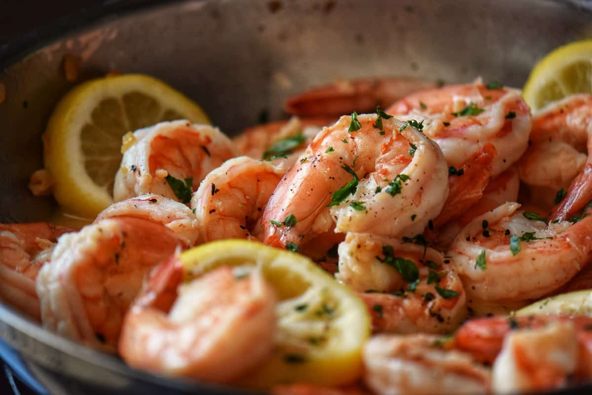 Shrimp in the process of being sauteed in a lemon wine sauce..