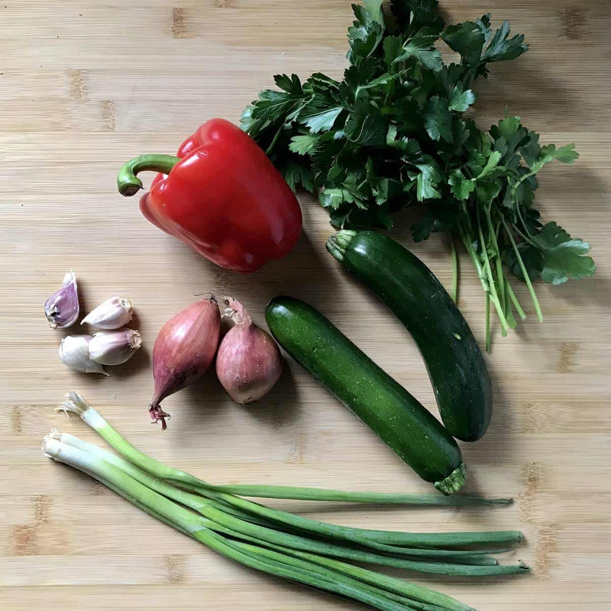 Different vegetables on a wooden board.