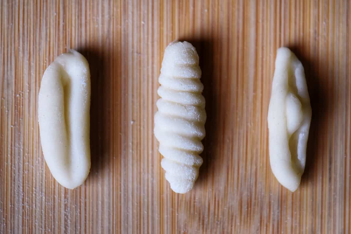 Three different shapes of cavatelli pasta.