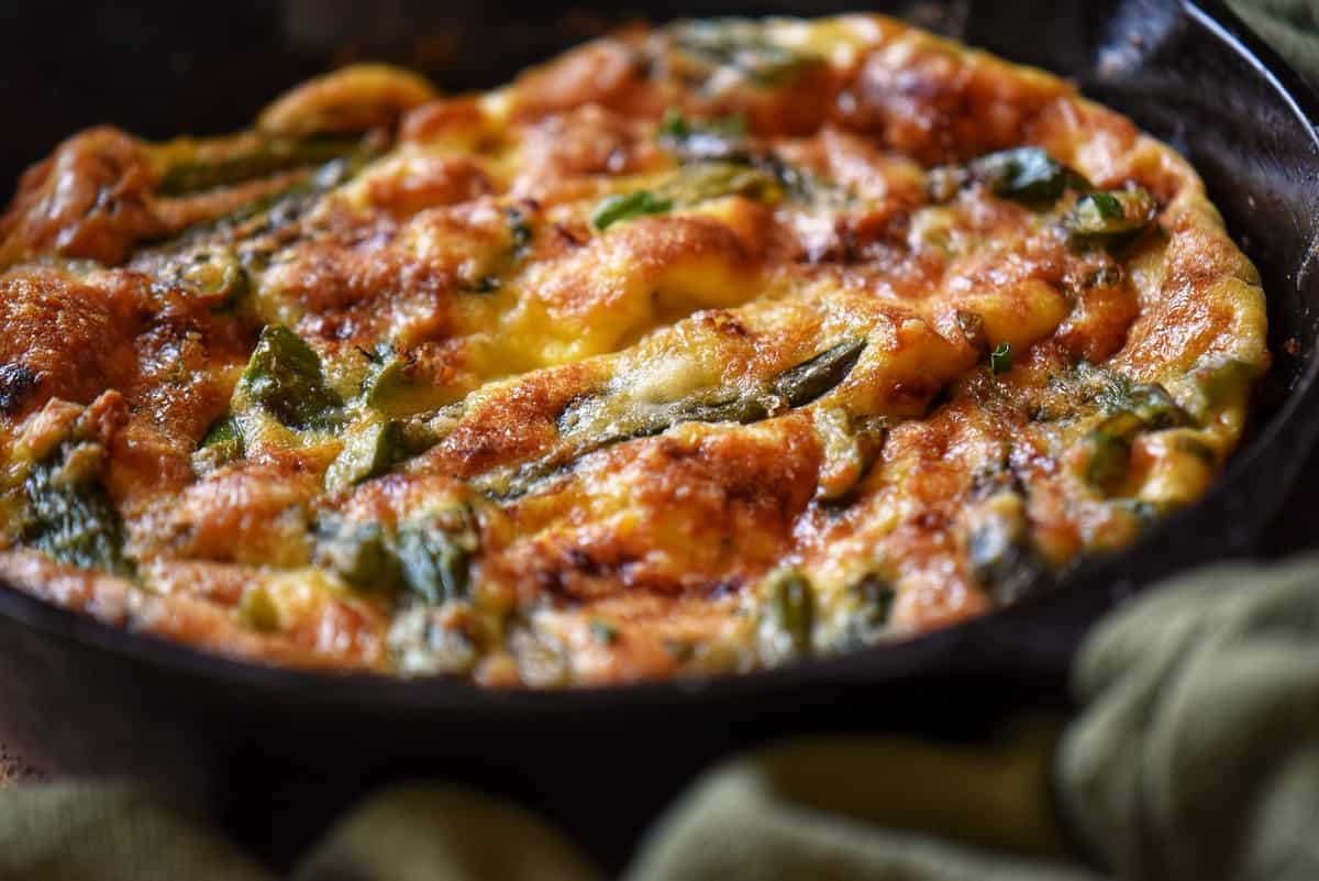 A close up of a freshly made Italian frittata recipe in a skillet.