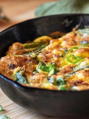 Asparagus Frittata in a dark pan.