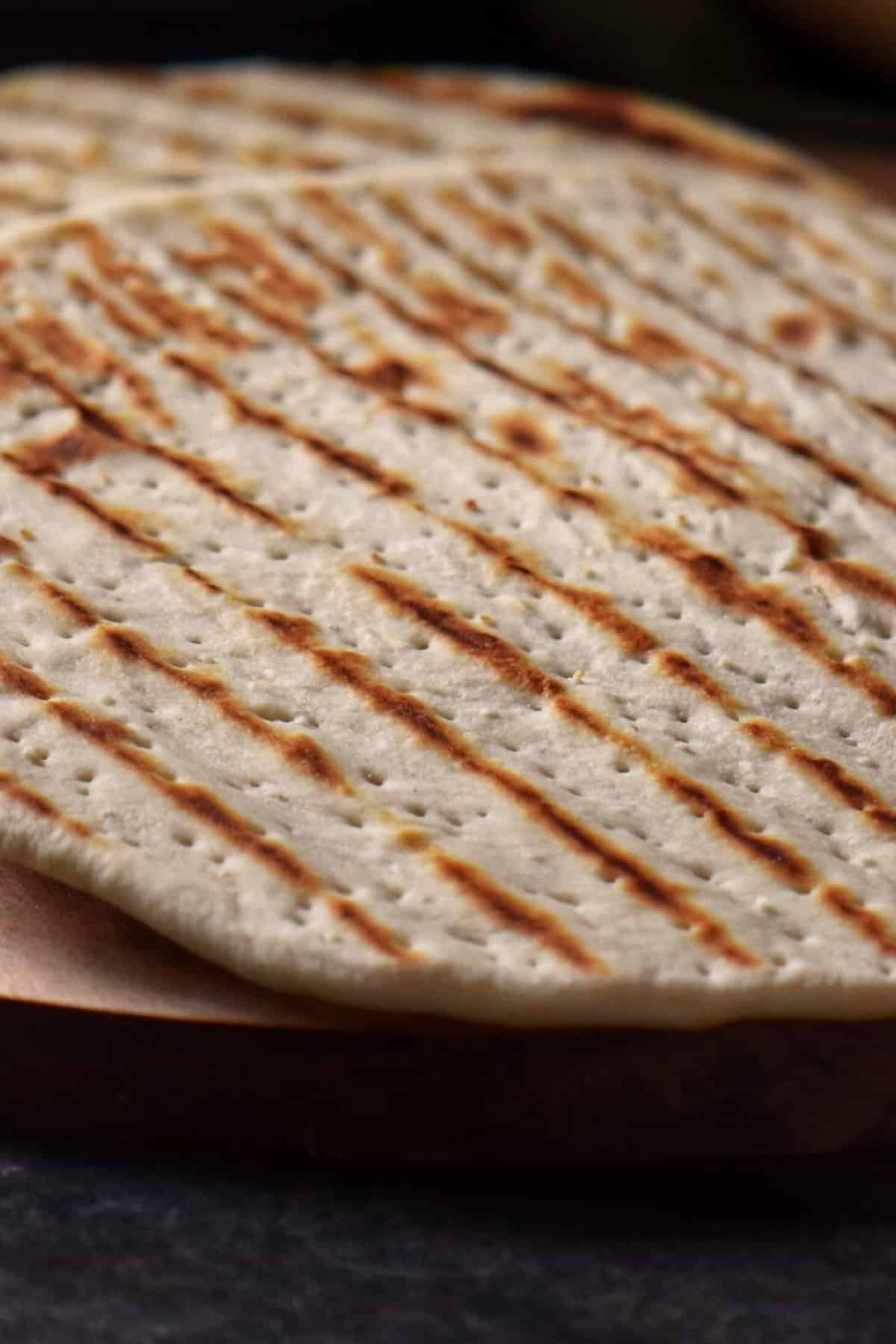 Pan grilled piadina on a wooden board.