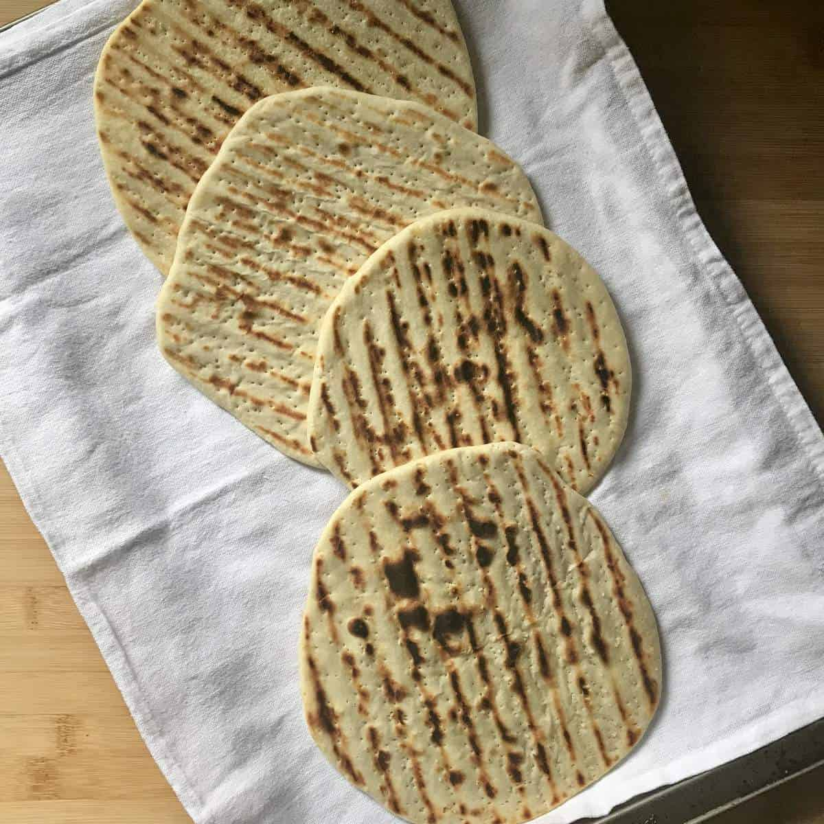 Grilled piadina in a tea towel.