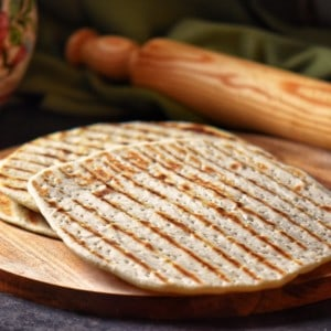 A few piadina on a wooden board.