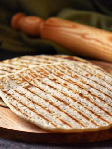 A few piadina on a wooden board.