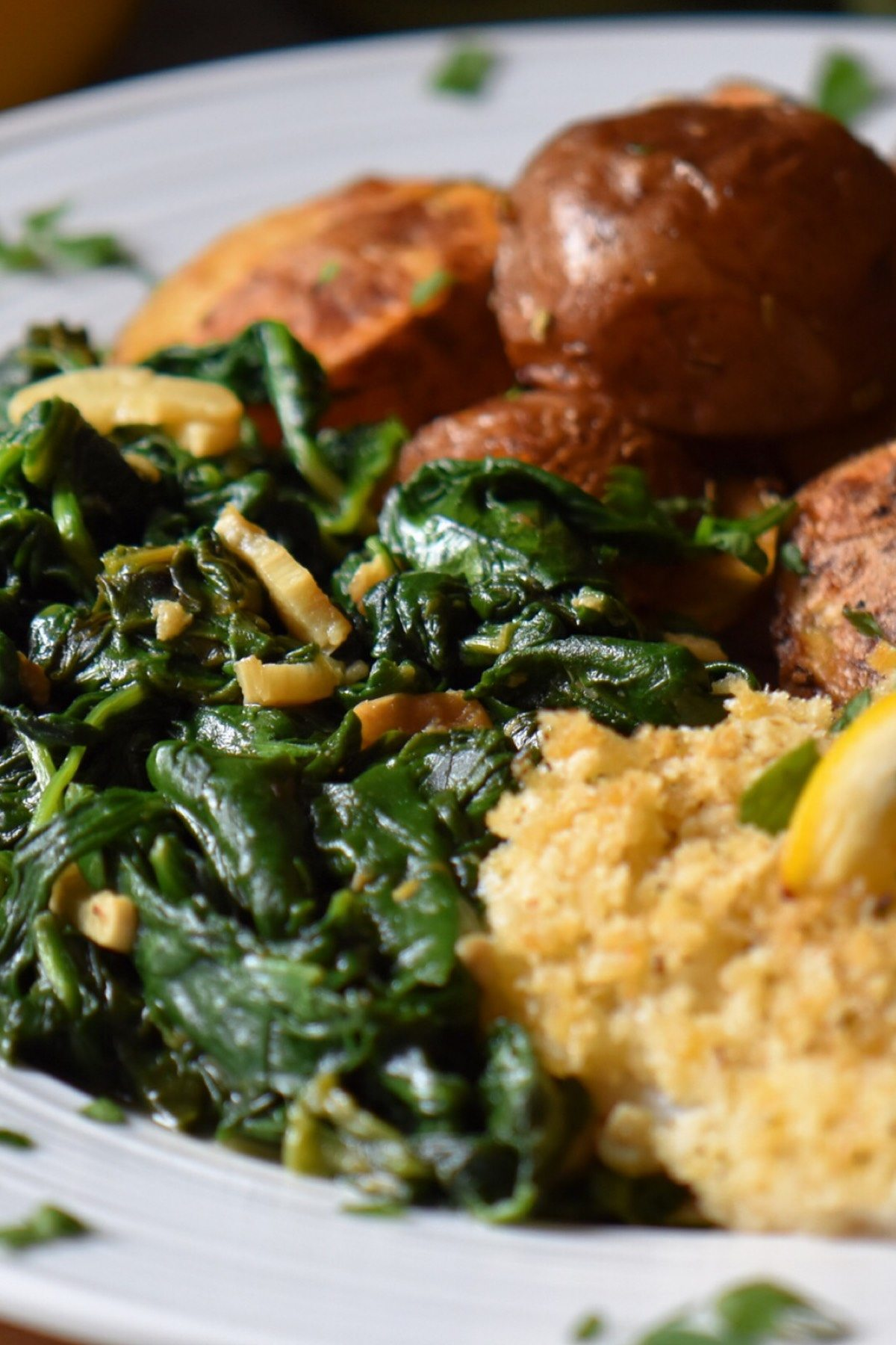 Sauteed spinach as a side dish in a white dinner plate.