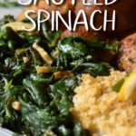 Sauteed spinach with garlic on a white dinner plate.