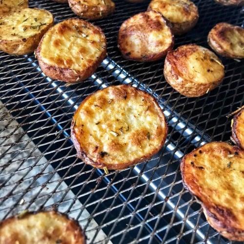 Roasted creamer potatoes on an air fryer basket.