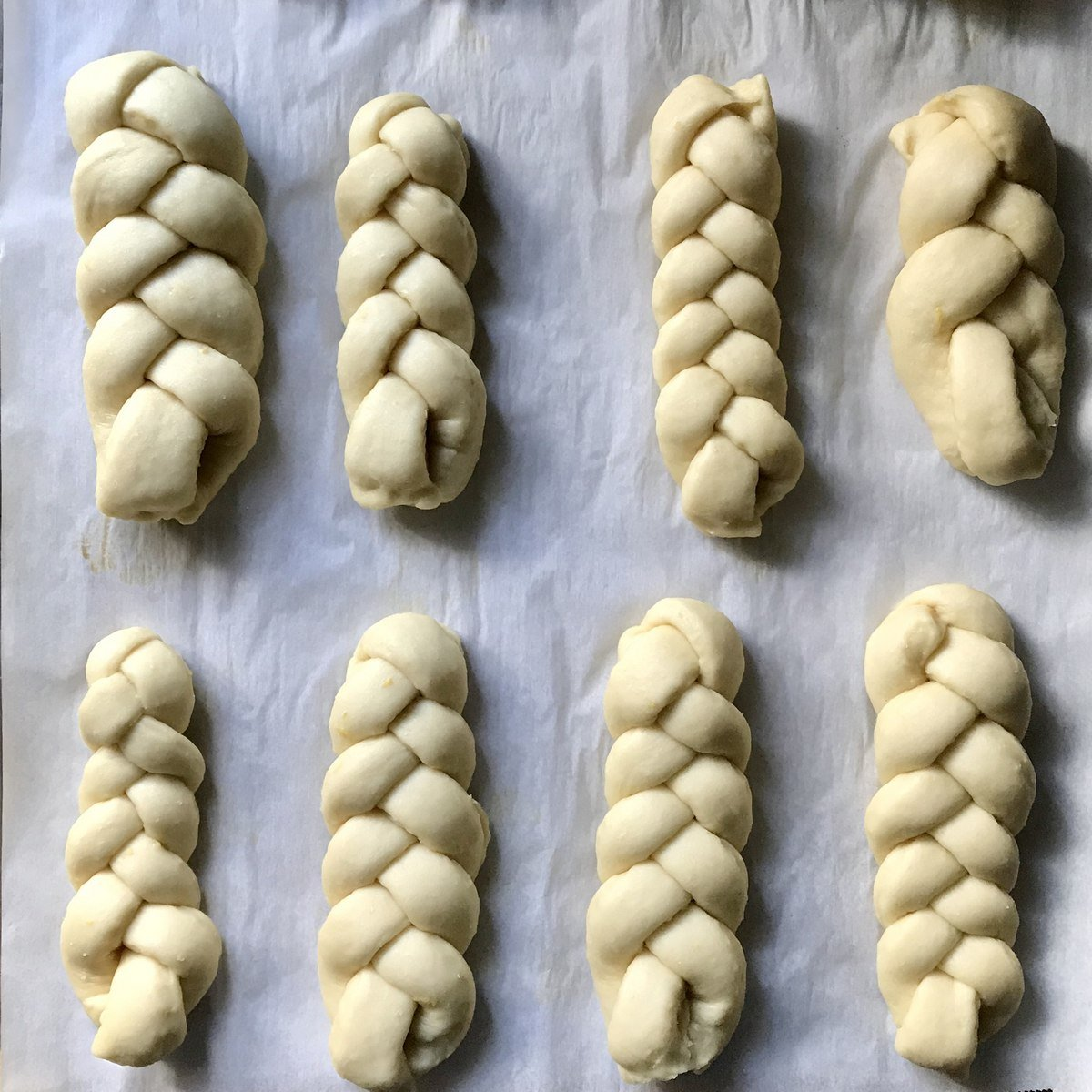 Braided sweet dough on a parchment lined cookie sheet.