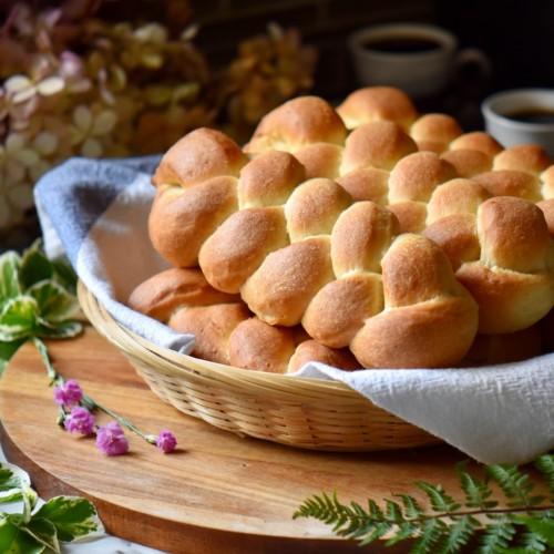 A braided sweet dough recipe in a wicker basket.