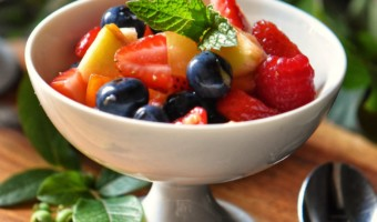 Fresh fruit salad in a white serving dish.
