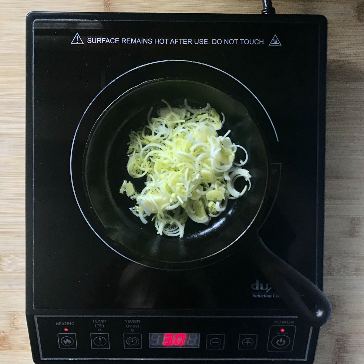 Sauteed leeks in a cast-iron pan.