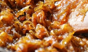 Golden brown caramelized onions in a pan.