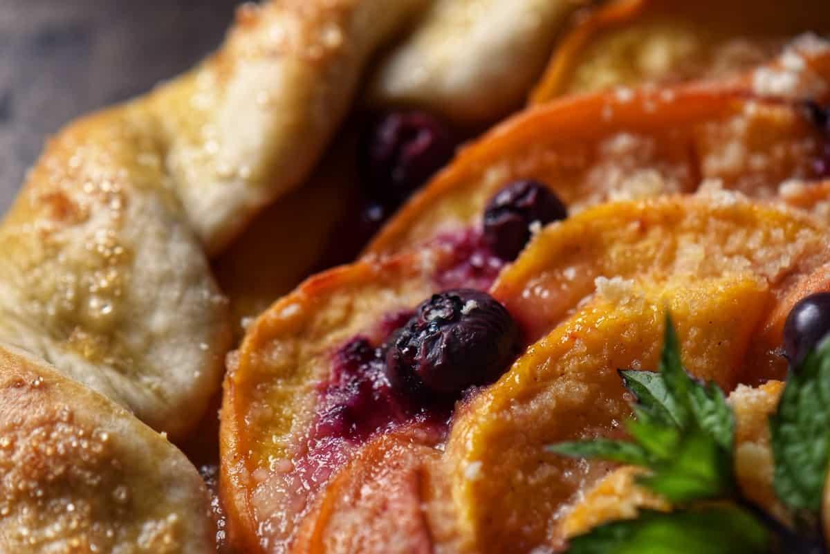 A close up photo of a peach crostata.