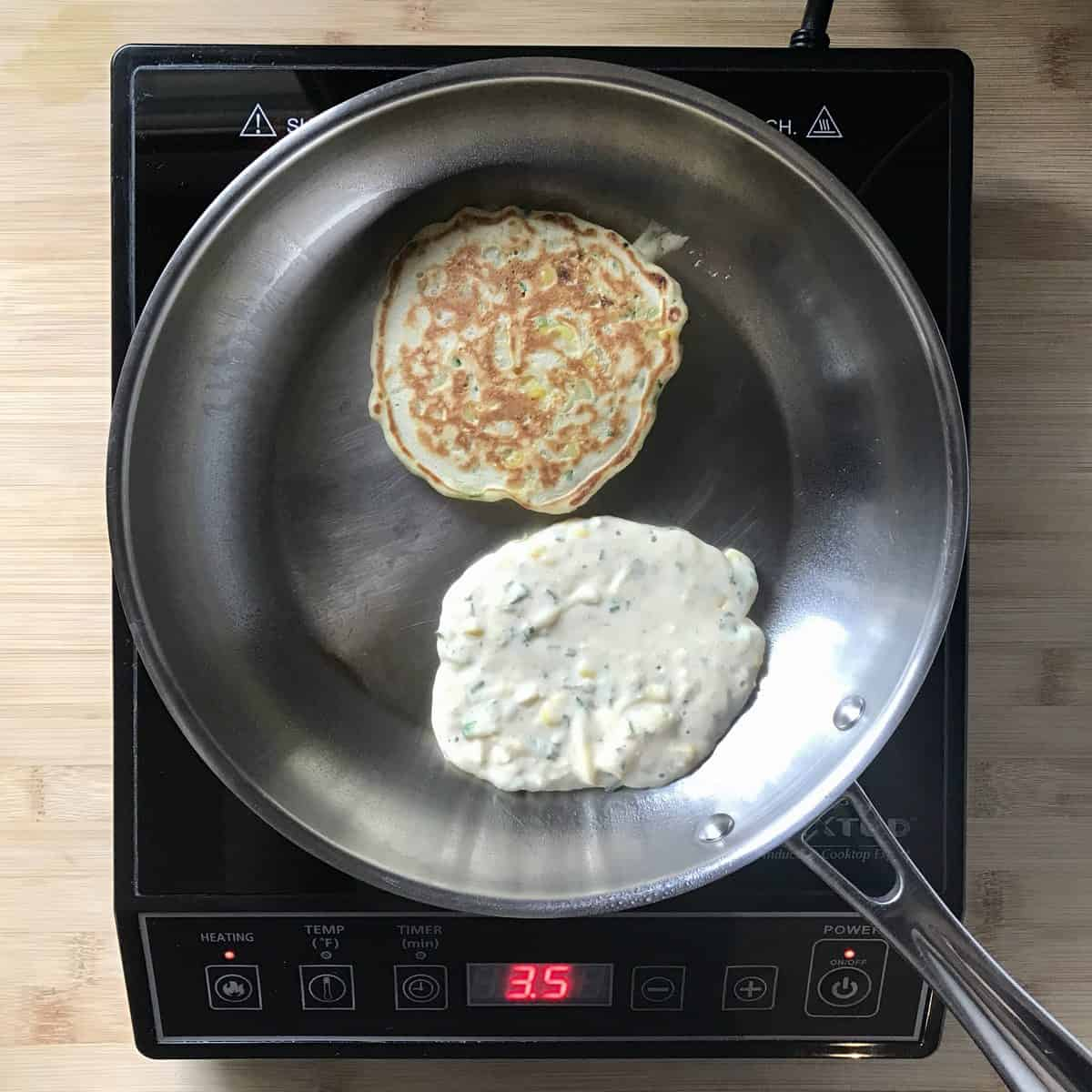 Zucchini pancakes in a pan.