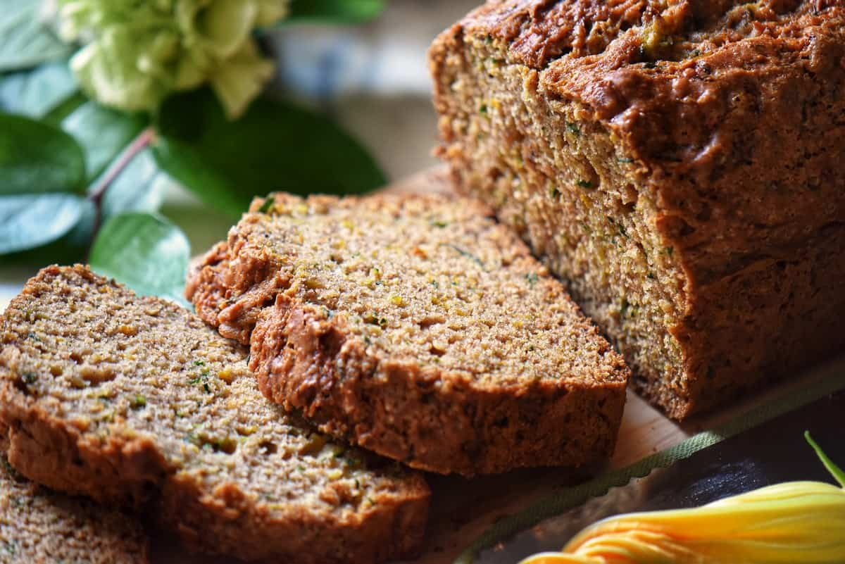 A close up of the tender crumb of a slice of healthy zucchini bread.