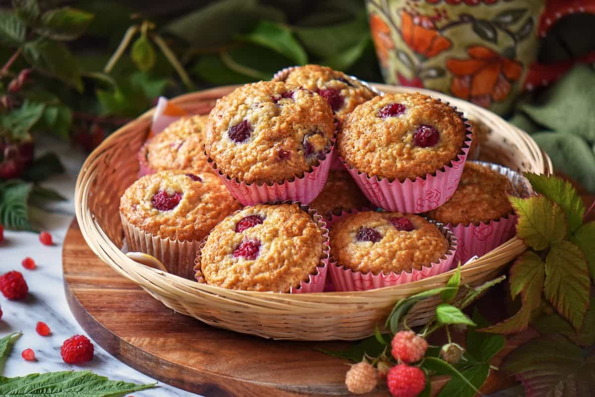 A basket of raspberry muffins.