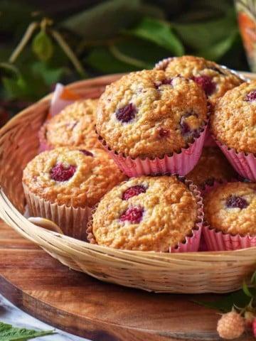 Raspberry muffins in a wicker basket.