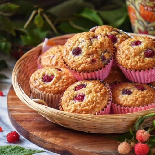 Raspberry muffins in a wicker basket.