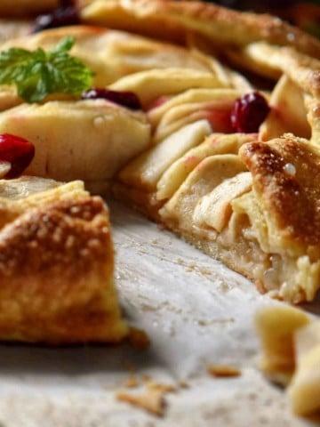 A slice of apple crostata missing from this Italian dessert.