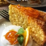 A slice of cake next to whipped ricotta, topped with orange syrup.