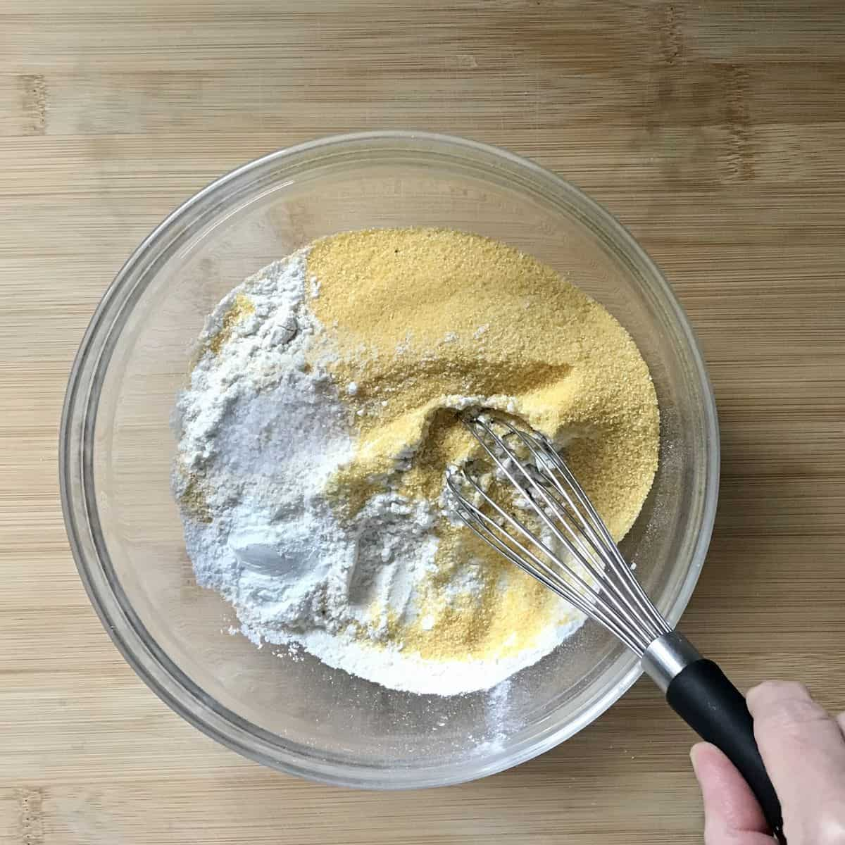 Dry ingredients being whisked together in a bowl.