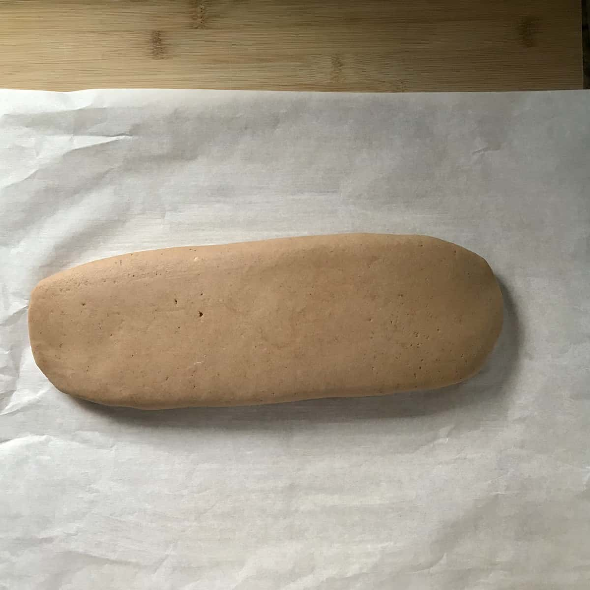 Biscotti log on parchment paper.