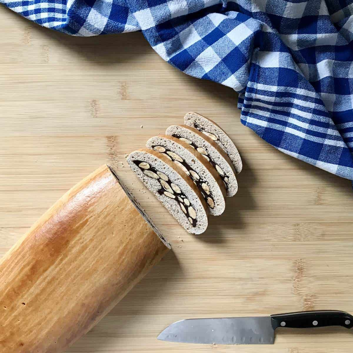 Sliced biscotti cookies on a wooden board.